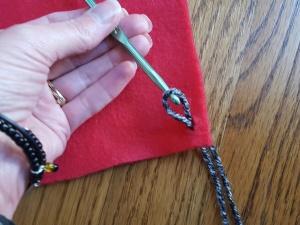 7c-pull-yarn-through-hole