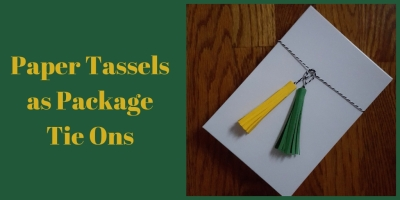 Paper tassels tied onto a gift box
