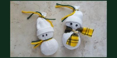 DIY sock snowmen wearing their favorite sports team colors